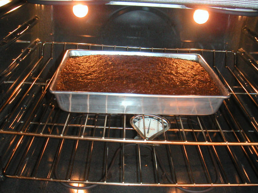 Bake at 400 degrees until the top springs back when touched. Don't open the oven for 1 hour.