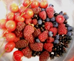 Fresh summer fruits - cherries, loganberries, raspberries, blueberries and blackcurrants