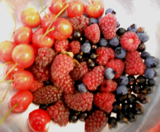 Fresh summer fruits - cherries, loganberries, raspberries, blueberries and blackcurrants