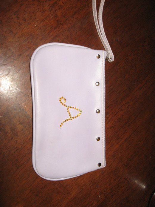 This little purse was $1. I put my granddaughter's initial on it with Swarovski stones.