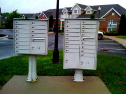THIS IS A POST BOX MAINTAINED BY THE OWNER OF THE APARTMENT AND HERE EACH APARTMENT IS ALLOTTED A BOX WHERE THE POST MAN KEEPS THE LETTERS WITH A MASTER KEY AND THE APARTMENT DWELLER COLLECTS IT FROM HIS ALLOTTED BOX WITH HIS KEY..