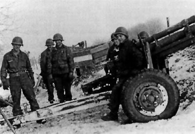 A 105mm gun section during the Bulge (591st FAB, 106th ID).