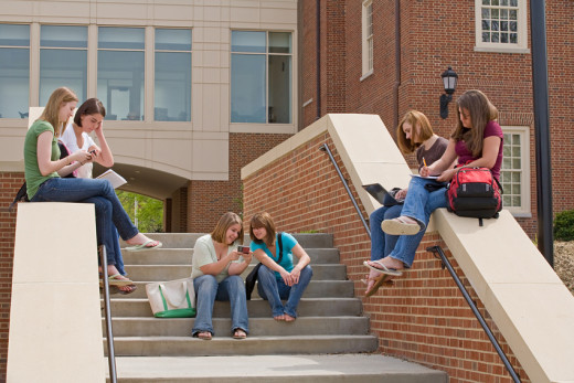 High School Students sitting on and around steps