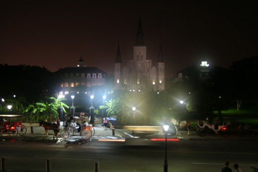 Jackson Square at night with St. Louis Cathedral behind
