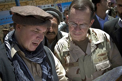 Greg Mortenson shows the locations of future village schools to U.S. Navy Adm. Mike Mullen, chairman of the Joint Chiefs of Staff, at the opening of Pushghar Village Girls School - 60 miles north of Kabul in Panjshir Valley, Afghanistan, 7/15/09.
