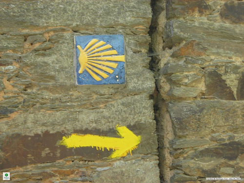 To walk the Camino, follow the yellow arrows and shells that mark the way