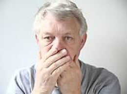 A man affected by the problem of bad breath