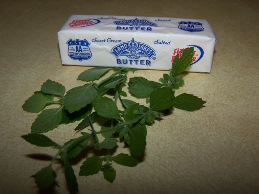 Butter and fresh Lemon Balm ready to be used.