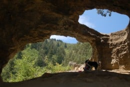 Brenda Snowden and dogs Ranger and Luna in Wind Cave, Uinta- Wasatch-Cache National Forest, Mount Naomi Wilderness