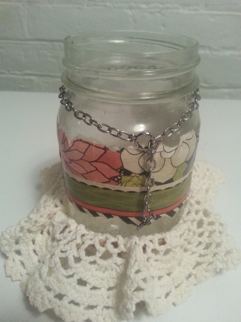 Tear a piece of scrapbook paper using a craft ruler, or freehand if you prefer, and adhere to the jar using Mod Podge.