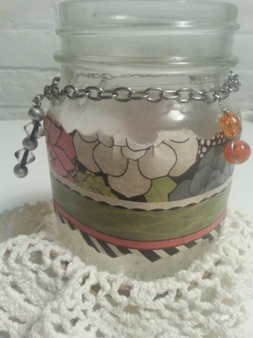 Cut a piece of jewelry chain and affix around the jar neck, complete with findings on the ends.
