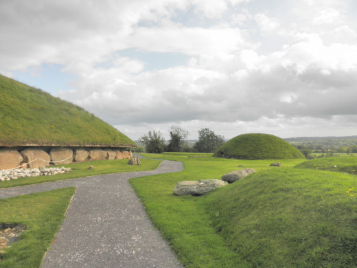 Walking among the mounds in Knowth. The Great Mound is to the left.