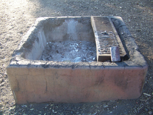 When leaving camp: The fire pit should be cool to the touch when you leave camp.  If you can't touch it, douse it with water until you can.