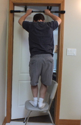 Standing up to get into the raised pull up position while doing negative reps.