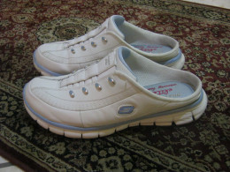 My Skecher's Women's Synergy - Elite Glam. I LOVE these shoes! They come in a choice of three accent colors, white with silver, light blue, or light pink.