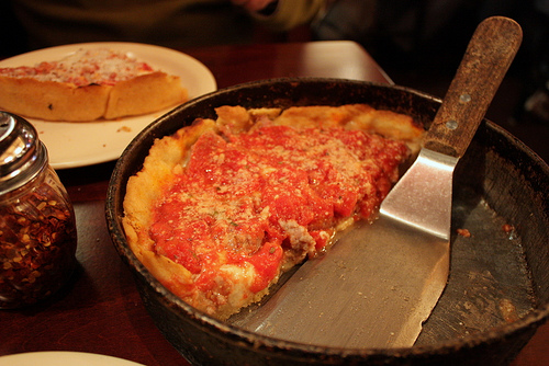 Chicago wins in a landslide!  Deep dish pizza is unequaled by New York's thinner, daintier variety.