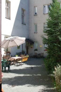 Courtyard at Downtown Dizzy Daisy Hostel in Krakow, Poland