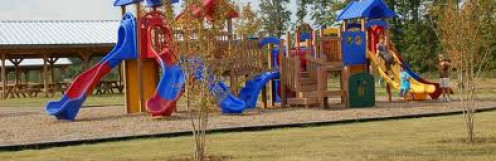 The playground inside Spring Park has slides, swings and seesaws. It's a wonderful place for children to play.