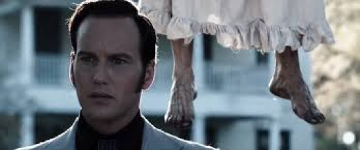 Patrick Wilson stars as Ed Warren in the R rated horror film entitled The Conjuring. The hanging dead girl is a witch that hung herself and pledged her love to the Devil.