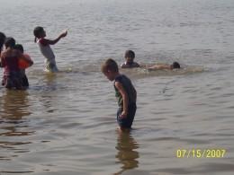Benicio, age 4, wading in Valencia, Jalisco.