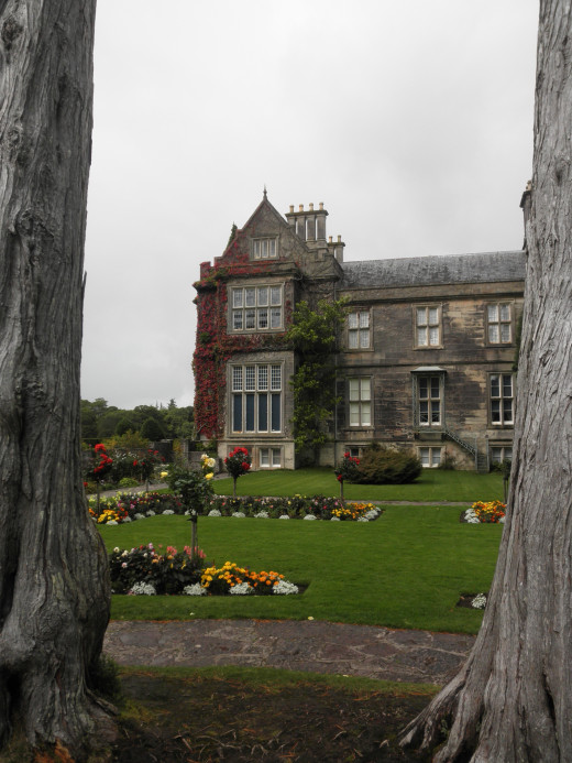 View of Muckross House from one of the formal garden areas.
