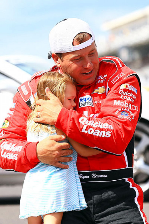 Newman celebrates with his older daughter on the yard of bricks at Indianapolis