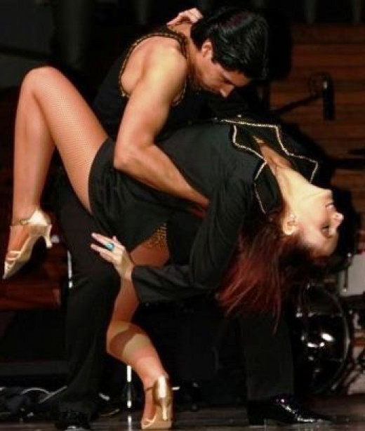 A more advanced bachata couple will be very close and comfortable with each other to be able to do complicated moves like this that require a lot of trust. The woman is relying on her partner to hold her up and is comfortable enough being this close