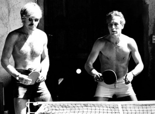 Actors Robert Redford and Paul Newman participate in a game of table tennis.