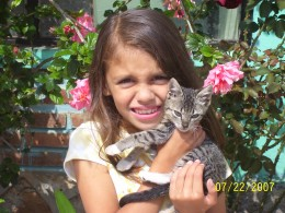 "Mari age 7 with ""Dooper"", a cat she made friends with in rural Michoacan. Remember, even if you don't bring your own pet, substitutes may be available :)"