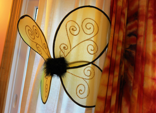 These fairy wings are attached to the curtains with a few well-placed pins.