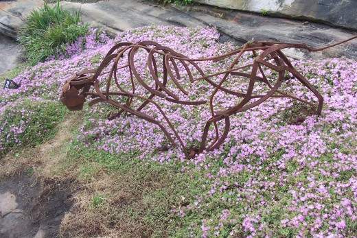 Panther on the prowl by Drew Mansur and Derek Mansur. Using scrap metal from their farm they designed and assembled this work to capture the movement and grace of the incredible wild animal.