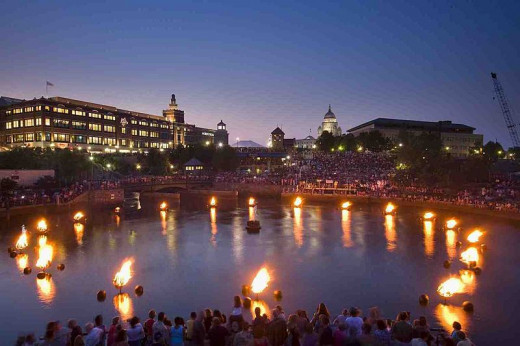 Waterfire light presentation by Barnaby Evans takes light into the darkness on the water.