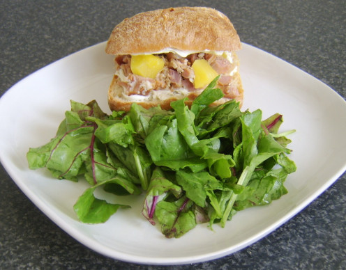 Ham, cream cheese and pineapple bread roll with mixed leaves salad