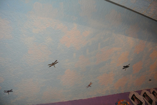 We painted a sky scene in the area of the room where the ceiling became uneven.  First, I thought this part of the room would cause a problem but it worked out perfectly.