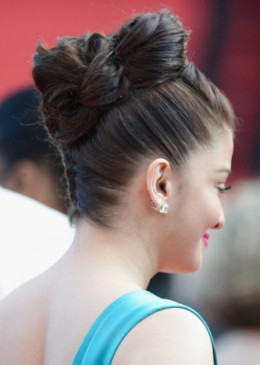 ntricate braid at the nape of Aishwarya's neck.