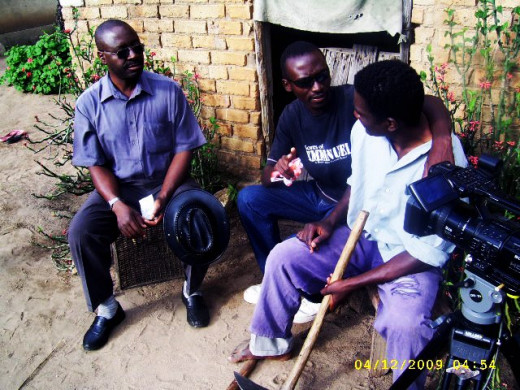"Director Edmore Ndlovu chats with cast on one of the locations for ""Sores of Emmanuel""."