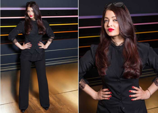 Aishwarya looking very slim in fitted pants at 2013 Cannes. Red lipsticks