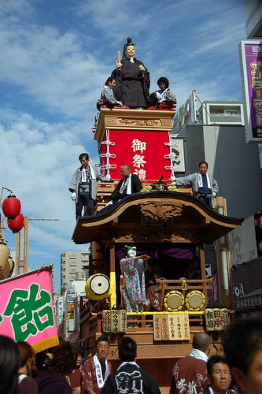 Elaborate effigies mounted on floats being paraded in the streets during the Kawagoe Festival