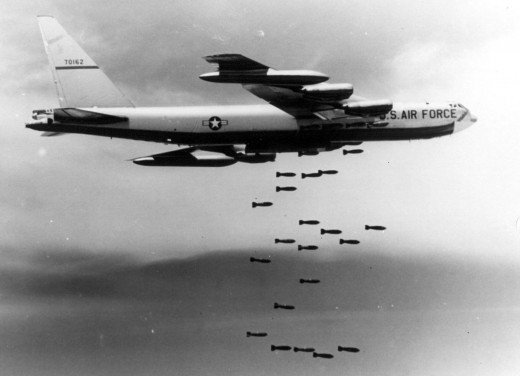 "A U.S. Air Force Boeing B-52F-70-BW Stratofortress (s/n 57-0162, nicknamed ""Casper The Friendly Ghost"") from the 320th Bomb Wing dropping Mk 117 750 lb (340 kg) bombs over Vietnam. The first B-52F used to test conventional bombing in 1964"