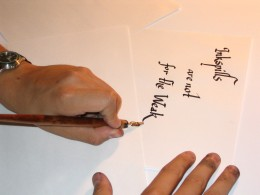 A way for the left handers to hold their pen.
