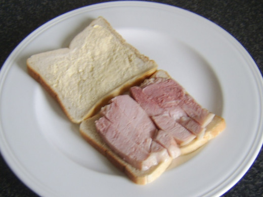 Ham slices are laid on buttered bread