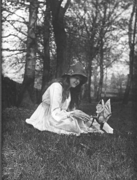 Elsie Wright with a fairy Taken in 1917, first published in 1920 in The Strand Magazine