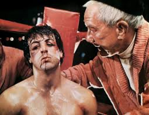 Rocky gets advice from Mickey(Burgess Meredith) in between rounds of his bout with champion Apollo Creed.