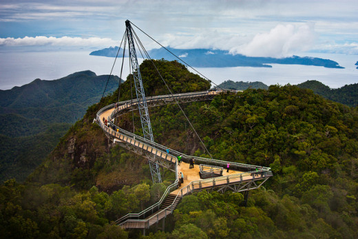 The curved bridge on the top of Gunung Mat Chinchang is held by a single pylon. This is the climax of your cable car trip.