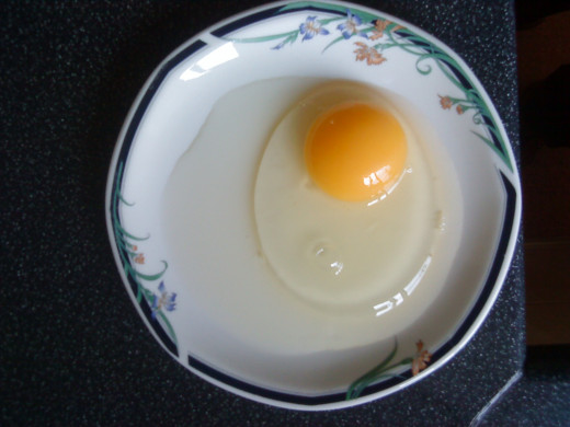 Crack your egg into a saucer or small plate.