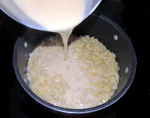 pour sauce over drained macaroni