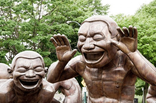 """Amazing Laughter"" sculpture by Yue Minjun"