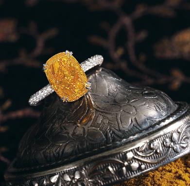 This 4.19 fancy vivid orange diamond ring sold for a world record price of $2.96 million. (approximately $700,000 per carat) The cushion cut orange diamond is set in an 18k white gold diamond ring.
