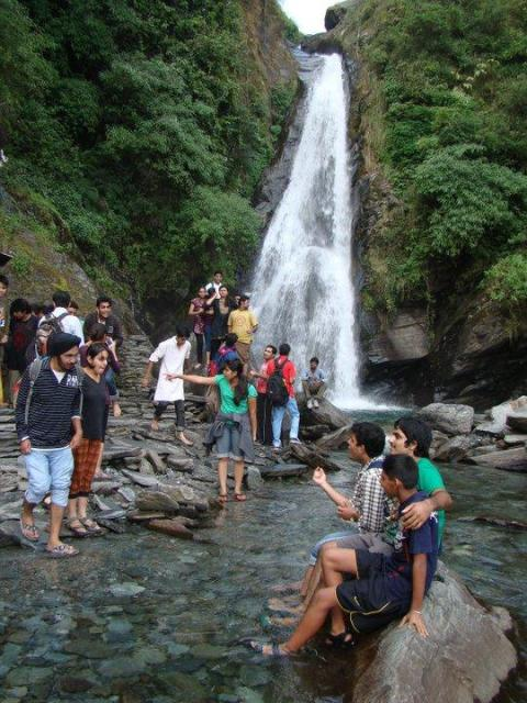 Tourist enjoying near waterfall
