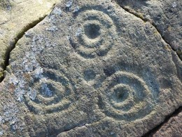 The cup and ring marks found on many ancient stones.